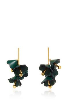 These earrings by **Marni** are rendered in a calf leather and gold tone brass and feature multiple stacked leather petals.