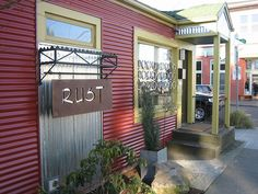 """Corrugated Metal Siding photo snapped by jenzug, shared via Flickr. She shares"""" Found this on 1920's bungalow style house with orange corrugated metal siding on Alberta St. in North Portland. We love the color combinations as well as the siding itself."""