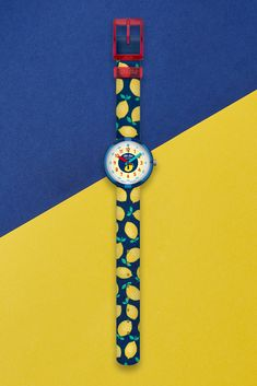 When life throws them lemons, the LIMONATA (ZFPNP061) tells kids it's time to make lemonade. Complementing the citrus print with a strong dark blue background and details, the design of this Swiss-made kids textile wrist watch in yellow makes wearing it a joy. The vibrant digital printed dial makes learning to tell the time fun, while the bright, comfy strap is machine washable at 40°C. Dark Blue Background, Telling Time, Lemonade, Swatch, Digital Prints, Vibrant, Strong, Joy, Bright
