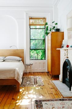 Dreamy fireplace in the bedroom with loads of nice wood and greenery views...mid-century goes modern.