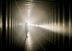 IPOcle warps reality inside a shipping container with layered luminescence - designboom | architecture & design magazine