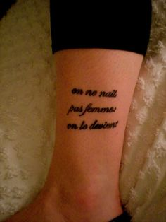 """tattoo is from existentialist philosopher and feminist Simone de Beauvoir'sThe Second Sex. The French """"on ne naît pas femme: on le devient"""" translates in English to """"one is not born, but becomes woman."""""""