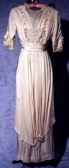 Here is a lovely example of a Titanic-era tea gown. Note all the trimming on the bodice and the skirt draping. Simply fantastic.