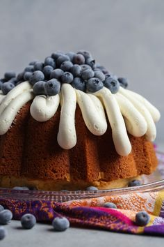 Million Dollar Pound Cake is straight out of my Grandma's recipe box. IT's buttery, dense, soft and moist. I topped mine with honey buttercream and fresh blueberries. It's the PERFECT pound cake! #recipe #bundtcake #cake #baking #cookiesandcups