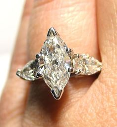 Marquise with pear side stones.  I think I found my future ring.