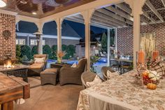 A cozy, covered dining area allows guests to eat food fresh off the grill while still keeping an eye on the kids in the pool. A pergola offers shade during the day and overhead lighting at night.