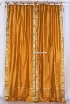 Indo Mustard Orange Tie Top Sari Sheer Curtain (43 in. x 84 in.) by Indian Selections. $28.83. Tie Top Curtains are popular for their casual and informal style that they create, and the simplicity of design. These fresh and light curtains add a delicate and decorative look to your windows and doors. Soft and semi sheer, they add just enough cover to your windows. Tie-back tops are 10 Inches long to allow for bow embellishments.*Sold per piece*Curtain measures 43 inche...