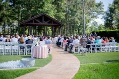 A beautifully set-up ceremony site with guests waiting patiently. Taken at THE SPRINGS in Lake Conroe by Alex White Photography.