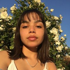 Natural no makeup look soft glossy lips with freckles and bangs . cute summer makeup look.