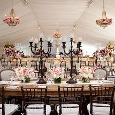Bare wood tables, rectangular tables, great ceiling treatment....but the chandeliers are wimpy.