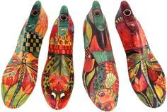 Shoe forms, painted and decoupaged. (Fit to hang on wall, insert dowel or similar, turn into hat or coat hangers).