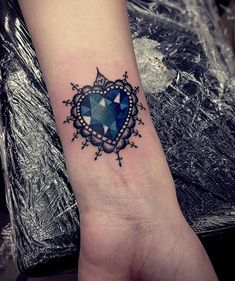 blue crystal heart tattoo