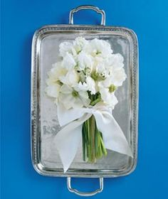 Create a one-of-a-kind wedding keepsake by renting an engraving pen from a hardware store and asking guests to sign their names on the platter.