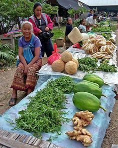 Morning market in Laos. Loved, loved, loved shopping the markets in the morning. Never tasted sweeter pineapple.