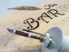 W.I.P - Pyrography - Sign made of cedar wood for the entrance of the house. http://www.facebook.com/laraartistjournal