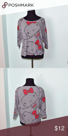 Adorable Hello Kitty Top In excellent condition! Very lightweight, stretchy, and soft! Buy 3 items and get 1 free plus 15% off your purchase total! Hello Kitty Tops Blouses