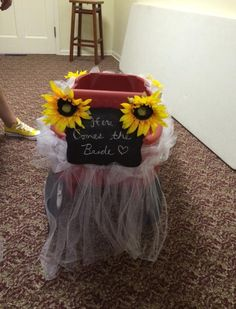 For the flower girl and ring bearer to ride down the isle in the wagon!