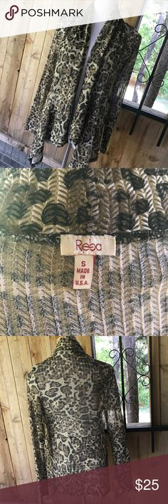 Reba leopard gold shimmer loose weave sweater Perfect to wear for an evening out or throw on with tights or jeans! Reba Sweaters Cardigans