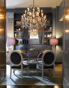 Molly Sims dining room is unquestionably chic with the oversized chandelier and addition of high sheen silver walls. Slate gray is a great complementary color to purple, bringing out the bluish tones inherent in purple.