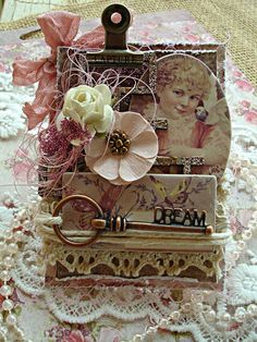Reneabouquets is having an April ATC Challenge and Giveway and Design Team Artist~Phyllis Fernandez created this gorgeous example using the following items used from ReneaBouquets.com and the Reneabouquets Etsy: ReB Glass Microbeads ~ Raspberry, Blue Fern Studios Chipboard Shabby Brick Bits, Prima Tales Of You And Me Flower, Prima Tales Of You And Me Collection Kit,  RB Natural Cotton Crochet Cluny Lace 001, RB Dream Metal Key, Prima Office Metals