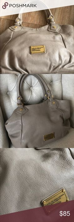 Marc Jacobs Greige Bag! Perfect versatile Marc Jacobs purse. Large enough to store your stuff but small enough to not be a Mary Poppins tote! Gorgeous greige color. Strap shows some evidence of wear but overall in very good used condition. Marc Jacobs Bags Hobos