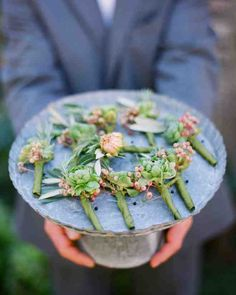 Each gent in the bridal party sported a small bundle of green ranunculus, olive leaves, and mountain ash berries on his lapel.