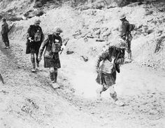 Three walking wounded from a Canadian Scottish Regiment coming in from the attack on Hill 70. 1917-09-15