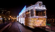 Guy Takes Long-Exposure Photo of Moving Train With Christmas Lights Attached Resulting in an Epic Photo