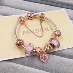 pandora charm bracelet with 7 pcs pink gold charms gold clasp head
