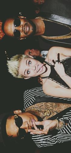 Wiz khalifa, Miley Cyrus, and Juicy J