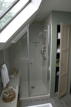 Another shower tucked under the eaves. Love the bench that continues as shelving outside the shower.