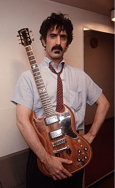 "Frank Zappa with his modified Gibson SG ""Baby Snakes."" (via http://www.pinterest.com/greywuf/)"