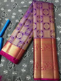 Purple pure kanchipuram silk saree with pink border