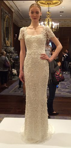 How sophisticated is this beaded column @marchesafashion gown? | Brides.com