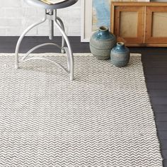 Skinny Mini Chevron Jute Rug - Black | West Elm - I like the look of this jute rug on a dark floor. Largest size is 6'x9' @ $199. Ideal for high-traffic area and would probably hide any crumbs!