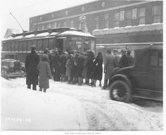 Boarding Troost Line Car, 1930 - the right choice for travel in bad weather, streetcars were packed during snowstorms.  There was a down side:  riders had to struggle through unplowed traffic lanes to reach streetcar loading zones.