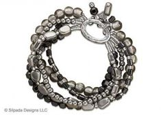 498699b848797 Strands of Sterling Silver Hematite and Glass Beads are strung together to  create this dynamic Stretch