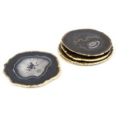 Glam Rock     Thin slabs of delicate high quality agate crafted into one-of-a-kind accent coasters with gold electroplate trim.  Each set of four has a unique character occasionally containing translucent and crystalline inclusions, and every coaster has padded feet.