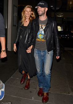 Look of love: Behati Prinsloo and Adam Levine couldn't stop smiling as they stepped out in London on Wednesday