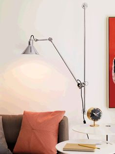 Shop the Lampe Gras Model 214 Wall Lamp, a modern wall light designed by French engineer and inventor Bernard-Albin Gras in the free of superfluous ornament, with a cast steel body and chrome or matte black finish. Vitra Design, Lamp Design, Lighting Design, Lighting Ideas, Dcw Editions, Lampe Gras, Modern Wall Lights, Modern Lighting, Modern Home Furniture