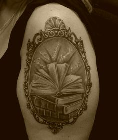 Book tattoo with frame made by Mircea in Holland