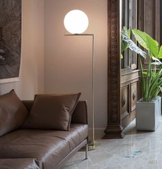 """The IC Lights F floor lamp was designed by Michael Anastassiades in 2014 and is a part of the IC Lights series."" The IC Lights F floor lamp is an amazing amalgamation of light and balance. This indoor contemporary floor lamp has a blown opaline glass diffuser and the body is finished with brassed or chrome steel. It also comes with a dimmer on the power chord. This designer floor lamp can be placed in any indoor space and emits a warm diffused light."