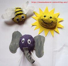 Soleil,éléphant, abeille réalisés avec des coquilles de noix