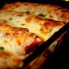 Chicken and a creamy tomato sauce are rolled up in tortillas for this chicken enchiladas recipe-very quick to assemble!