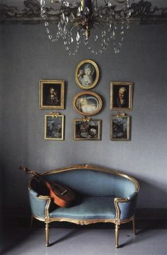 This room holds massive appeal for me - perfect grey walls, framed antique portraits, fab chaise and more. Wonderful