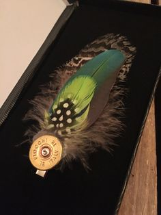 Feather lapel or hat Pin Feather lapel or hat Pin Feather Jewelry, Feather Earrings, Silver Hoop Earrings, Tribal Feather, Feather Design, Barrette, Shotgun Shell Crafts, Bullet Crafts, Feather Crafts
