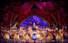 Be Our Guest, Belle and the enchanted objects on the Broadway stage.