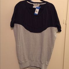 Adidas originals tunic! Rare! Adidas originals tunic. Scoop neck, oversized style. Perfect with leggings. Size xs. NWT. Pockets and detailed across chest. Rare find! Adidas Tops