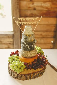 If you don't fancy cake, try a 'cheese cake' instead. Photo by Benjamin Stuart Photography #weddingphotography #cheesecake #wedding #barnwedding