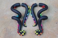 Hey, I found this really awesome Etsy listing at http://www.etsy.com/listing/109335879/rainbow-tentacles-gauge-or-fake-gauge